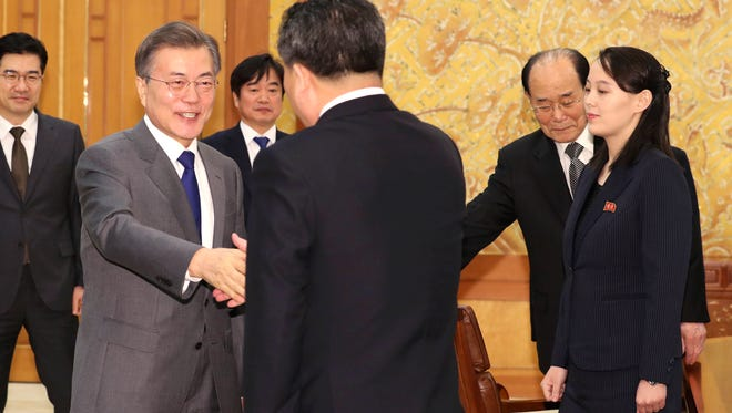 South Korean President Moon Jae-in (left) shakes hands with Ri Son Gwon, chairman of the North Korea's agency that deals with inter-Korean affairs, as Kim Yo Jong (right), sister of North Korean leader Kim Jong Un, watches before a meeting at the presidential house in Seoul, South Korea.