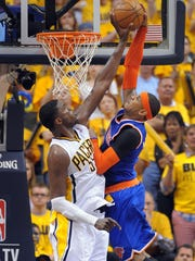 Roy Hibbert blocks the dunk attempt by the Carmelo