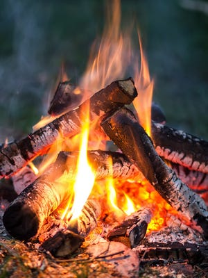 bonfire of wood burning in the evening