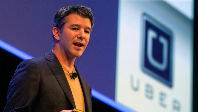 Former Uber CEO Travis Kalanick delivers a speech in London on October 3, 2014.
