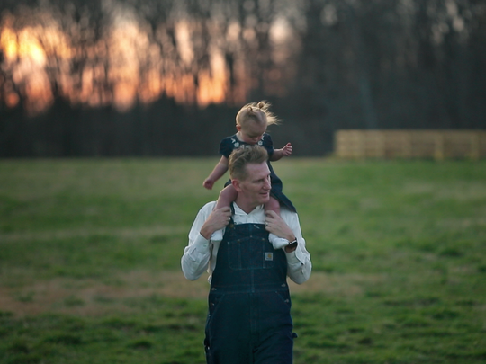Rory Feek walks with daughter Indiana, 2, on his shoulders.
