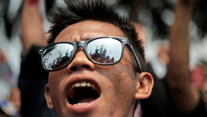 A worker shouts slogans during a May Day rally outside the presidential palace in Jakarta, Indonesia, on May 1.