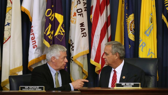 House Veterans' Affairs Committee Chairman Jeff Miller (R-Fla.) (R) talks with ranking member U.S. Rep. Michael Michaud (D-Me.) before a hearing about the ongoing scandal about access to VA doctors appointments in the Cannon House Office Building on Capitol Hill June 9, 2014 in Washington, DC. An audit was released Monday detailing fake waiting lists for health care access for veterans, a revelation that resulted in last month's resignation of Veterans Affairs Secretary Eric Shinseki.