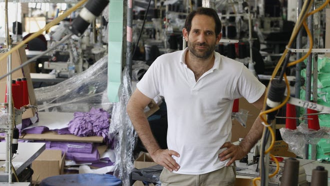 In this April 3, 2012 photo, Dov Charney, founder of American Apparel, is photographed at the company's factory in downtown Los Angeles.