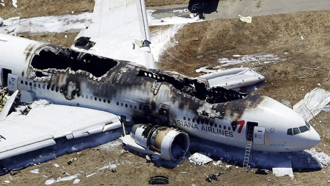 Asiana Airlines Flight 214 crashed July 6, 2103, at San Francisco International Airport. The National Transportation Safety Board will release its report into what caused the crash Tuesday, with recommendations to avoid another.