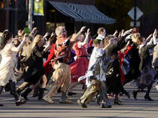 Zombies will talk over downtown Sioux Falls Saturday evening for the annual walk.