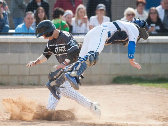 Sky Duff of Bishop Eustace and Paul VI catcher James Towson collide during a play at the plate in the second inning. Duff was safe on the play.