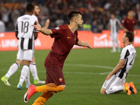 Roma's Stephan El Shaarawi celebrates after scoring during a Serie A soccer match between Roma and Juventus, at Rome's Olympic stadium, Sunday, May 14, 2017. (AP Photo/Gregorio Borgia)