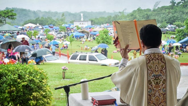 Hundreds attend All Souls' Day Mass at Guam Memorial Park on Nov. 3, 2014.