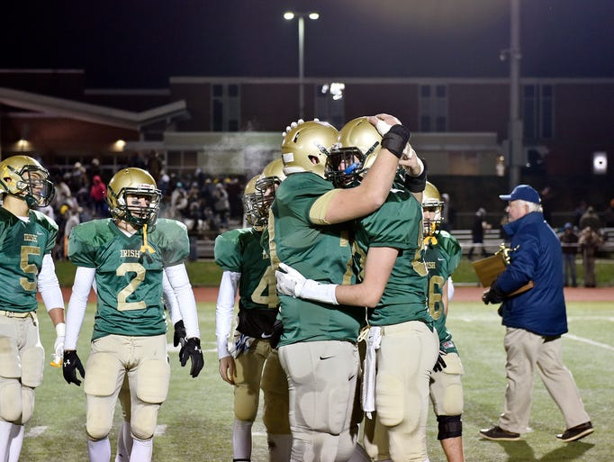 York Catholic football players greet each other after