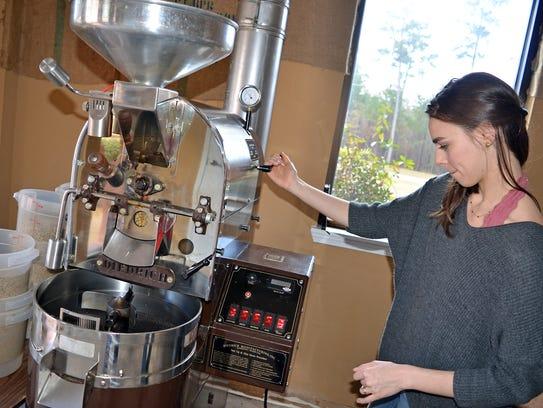 Emma Salina checks temperature of roaster, making sure