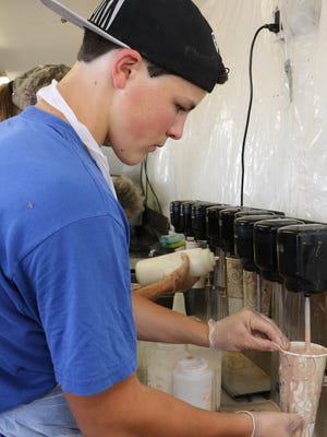 Timothy Hempel, of Tivoli, makes a milkshake at the Dutchess County Fair in Rhinebeck on Tuesday.