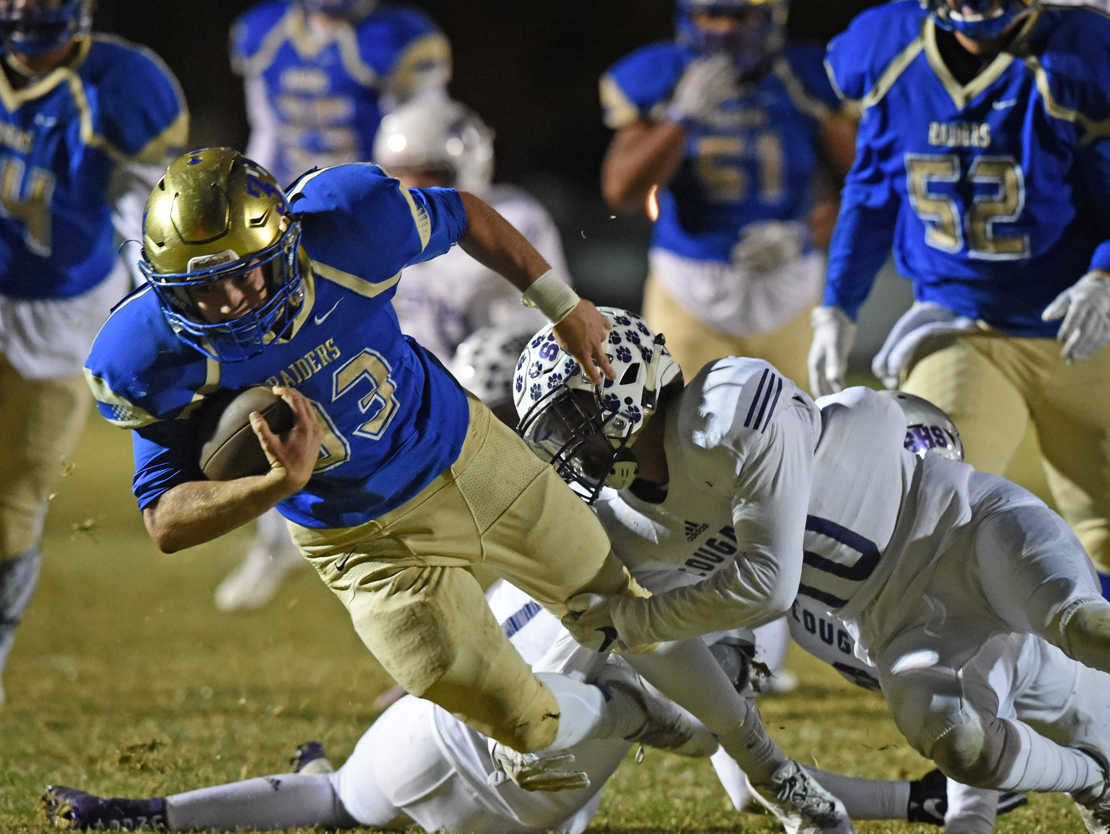 Reed's Nick Striejewske is tackled by Spanish Springs' Colton Allen at Ree don Oct. 27, 201 6.