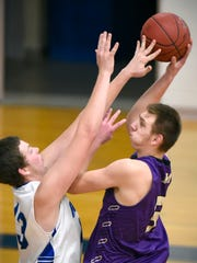 Melrose's Brady Birch gets a shot off over Watertown-Mayer's