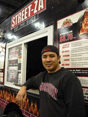 Steve Mai of Streetza Pizza, Milwaukee, sells pizza by the slice from his mobile, 650-degree oven. The food truck fare ranks high nationally.