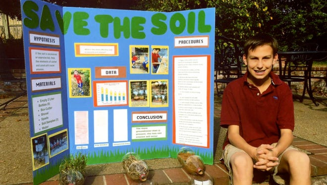"Wesley Hollbrook with his winning science fair project, ""Save the Soil."""