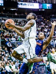 MSU's Lourawls Nairn scores past Illinois' Ahmad Starks Saturday. Nairn played 15 minutes, providing an element of quickness lacking elsewhere, and should have played more.