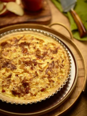 This undated image released by The Culinary Institute of America shows a cheese and onion tart in Hyde Park, N.Y.  This dish is assembled much like a quiche.