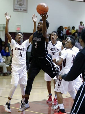 Seton Hall signee Myles Cale, shown here against Hodgson on Dec. 8, has helped the fourth-ranked Jaguars to a 6-1 start.