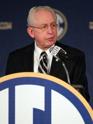 SEC commissioner Mike Slive talks to the media during the SEC Football Media Days at the Wynfrey Hotel.