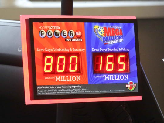 A electric sign at the Speedway gas station at Keystone Avenue and 62nd Street shows the current Powerball jackpot  of $800 million on Friday, Jan. 8, 2015.