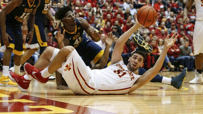Iowa State senior Georges Niang pushes the ball to a teammate after scrambling for a rebound against West Virginia on Tuesday, Feb. 2, 2016, at Hilton Coliseum in Ames, Iowa.