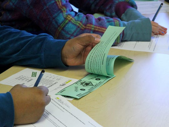 "Apache Elementary School students estimate their college expenses after they were given pretend money during Shi'yaz'hi ""My Little One"" College Day on Fridayat the south campus of Diné College in Shiprock."