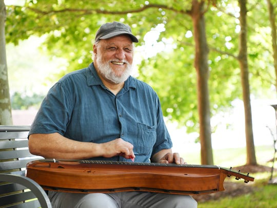 Don Pedi plays his dulcimer at Pack Square Park to