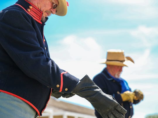 David Johnson, left, and Mike Bitner get ready to fire a cannon during Fort Concho Museum Day Saturday, July 15, 2017, in San Angelo.