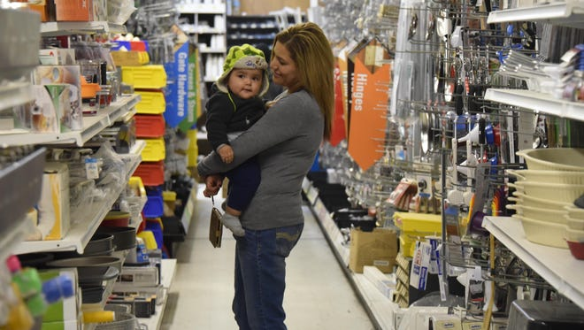 Vanessa Velez and son Ivan Valez shop at Giomi's Ace Hardware during the store's 45th anniversary celebration last Saturday in Yerington.