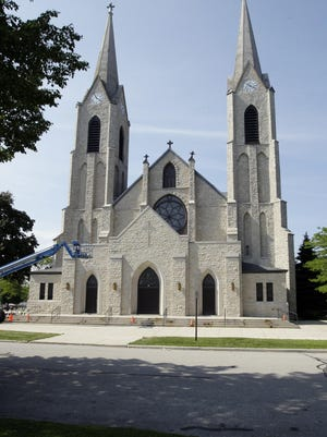 Crews have begun painting the exterior of Holy Name Parish. A capital campaign is underway to raise funds to repair the landmark building.