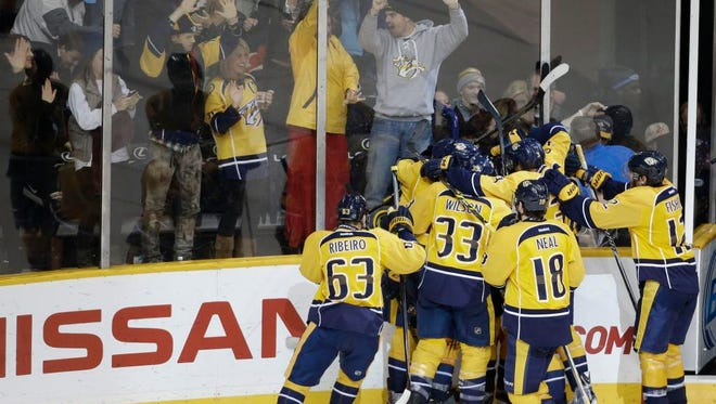 Predators players celebrate after an overtime goal by Filip Forsberg gave them a 1-0 win against the Edmonton Oilers.
