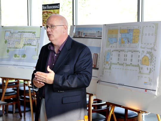 Steve Hayward, executive director of the Lansing Township DDA, unveiled plans for The Heights at Eastwood in June 2012 .