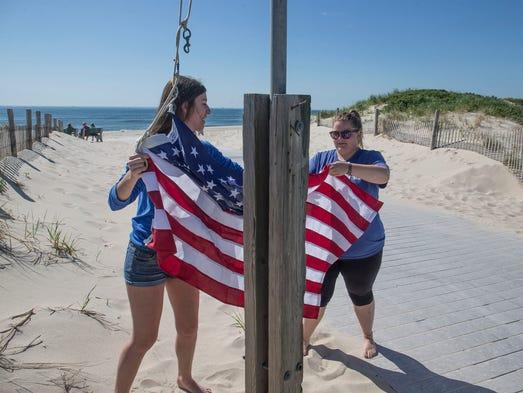 Seaside Park Beach Control employees raise the flag