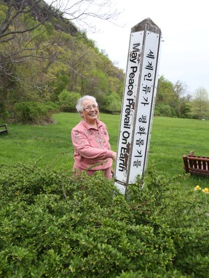 Sister Veronica Mendez, president of Sisters of Our Lady of Christian Doctrine, stands near the Peace Pole at the Marydell Faith and Life Center in Upper Nyack on May 6.