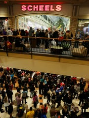 Black Friday shoppers gather as they wait for the Scheels store to open its doors at the Jordan Creek Town Center in West Des Moines on Black Friday.