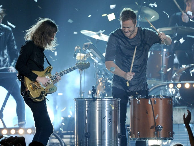 Wayne Sermon, left, and Dan Reynolds, of the musical group Imagine Dragons, perform at the Billboard Music Awards at the MGM Grand Garden Arena on Sunday, May 18, 2014, in Las Vegas. (Photo by Chris Pizzello/Invision/AP)