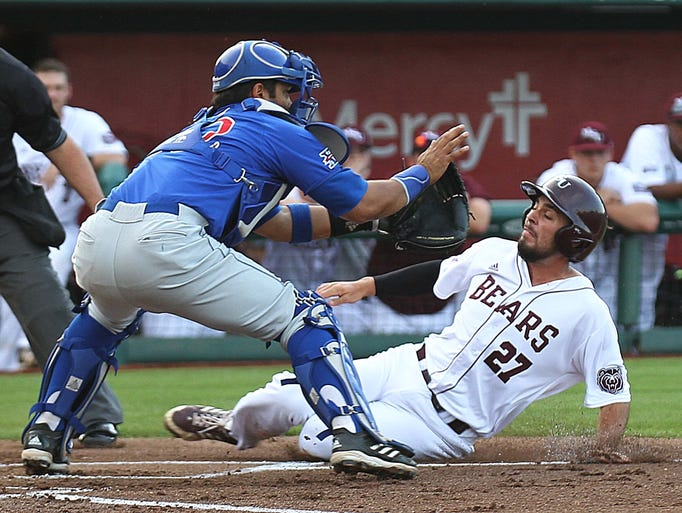 Missouri State's Dylan Becker moments before he is tagged out by Ka'iana Eldredge of the Kansas Jayhawks at Hammons Field on May 7, 2014.