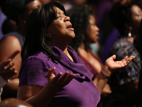Edith Walker participates in Mt. Zion Baptist Church's service dressed in purple for cancer awareness on Sunday.