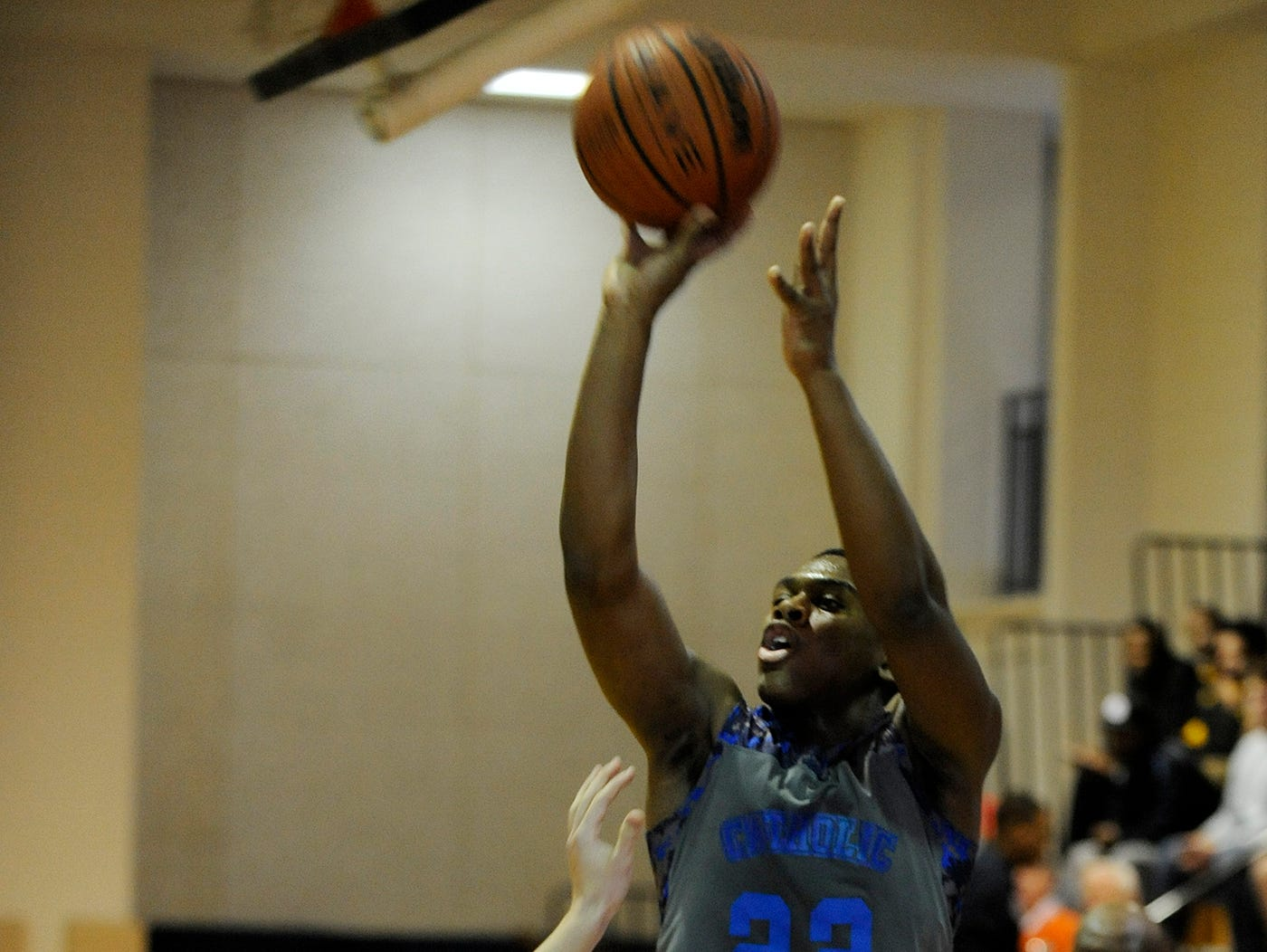 Catholic's Reginald Gee shoots a three point shot against St. James at the St. James campus in Montgomery, Ala. on Saturday February 7, 2015.