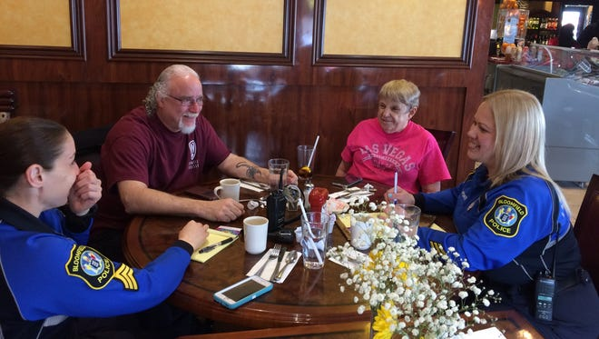 From left, Bloomfield Sgt. Naomi Zepeda, residents Al Yorkelson and Judy Johanson, and Officer Yesenia Aponte chat over coffee at Nevada Diner in Bloomfield Tuesday morning, March 21, 2017.