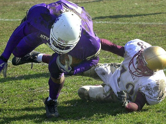 Iona Prep's Christopher Gazzola (13) can't tackle New
