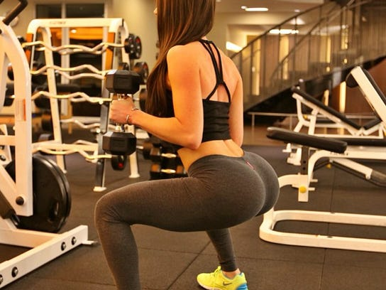 "Jen Selter practices her famous squats; her ""fitness inspiration"" photos draw thousands of followers and comments on Instagram."