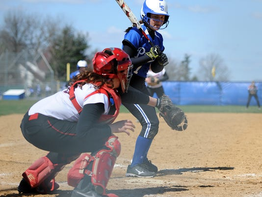 Lampeter-Strasburg's Jordyn Kondras closely watches a pitch from Warwick's Amanda Herr at Lampeter-Strasburg High School on Saturday, April 11, 2015. The Warriors won 10-0. Patrick Blain for GameTimePA.com