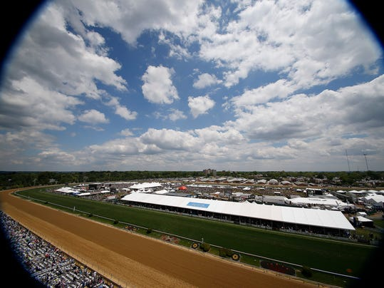 In this photo made with a fish eye lens, People line the infield and grand stand before the 139th Preakness Stakes horse race at Pimlico Race Course, Saturday, May 17, 2014, in Baltimore.  (AP Photo/Mike Stewart)