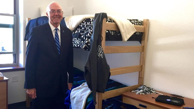 UNR President Marc Johnson tours a room at Peavine Hall, the newest residence hall to open.
