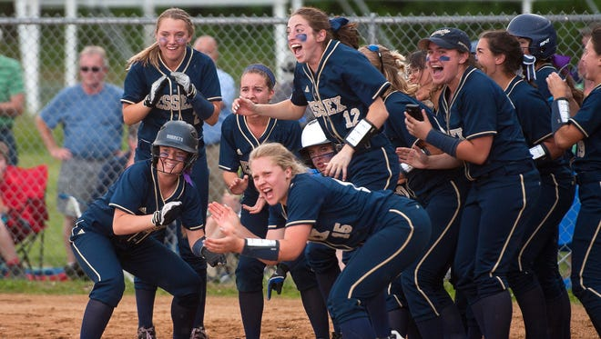 Essex players wait at home plate to celebrate Makenna Thorne's game-tying home run in the sixth inning against Colchester during Tuesday's Division I softball semifinal.