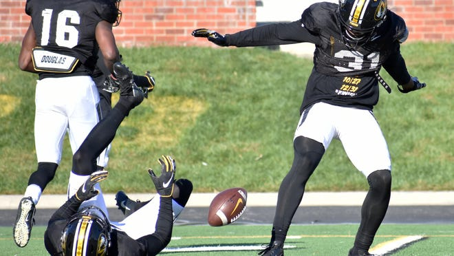 Missouri safety Martez Manuel (31) signals an incomplete pass after batting the ball away from teammate Aidan Harrison during an October 2019 team practice at Faurot Field.