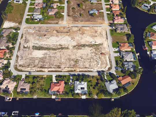 A Cape Coral infill project two years in the making is building 14 upscale homes around their own park between Southwest 18th Place and Southwest 19th Place.