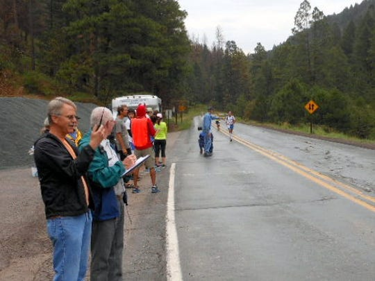 Mike Shafer, left, and Rickie Prichard of the Sierra Blanca Amateur Radio Club help out during the last running of the Ski Run Road Challenge.